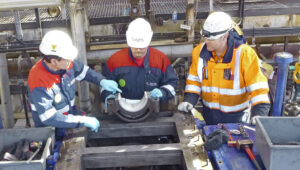 Burckhardt Compression and Varo employees working together on compressor on site